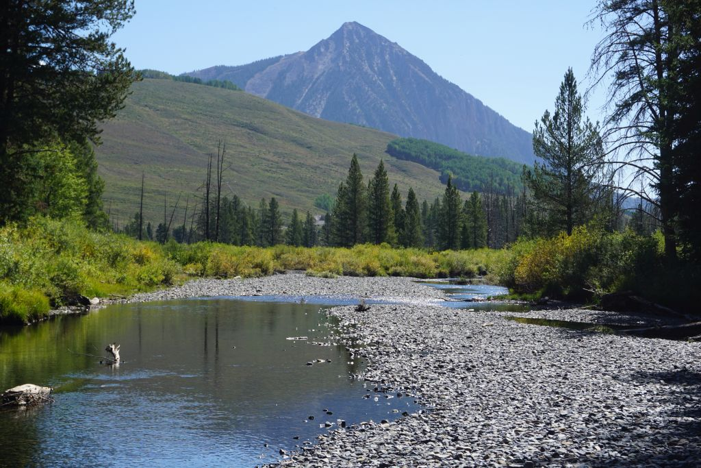 Hiking along Slate River with Crested Butte in the background